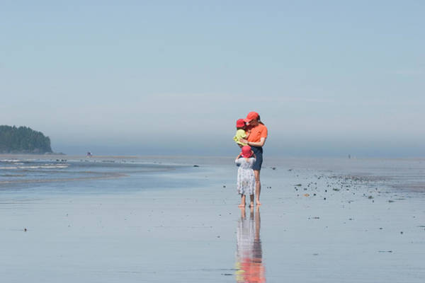 Wall Art - Photograph - Young Mother Walks Along Beach by Henry Georgi