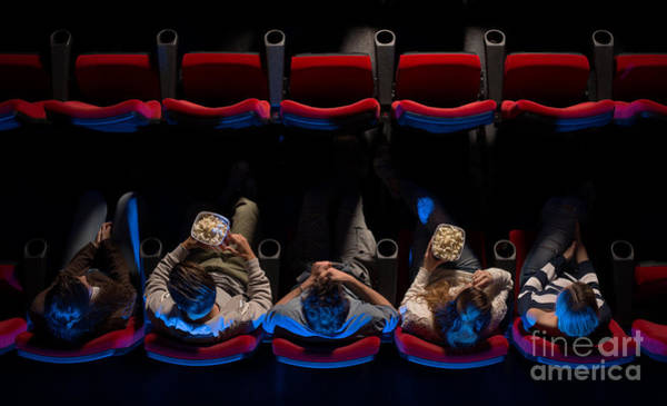 Indoor Photograph - Young People Sitting At The Cinema by Stock-asso