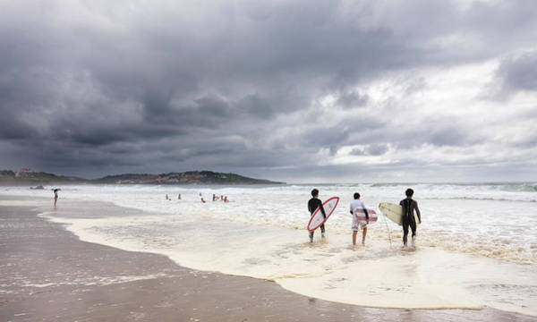 Water Sport Photograph - Young Surfers Entering Sea At Meron by Diego Lezama