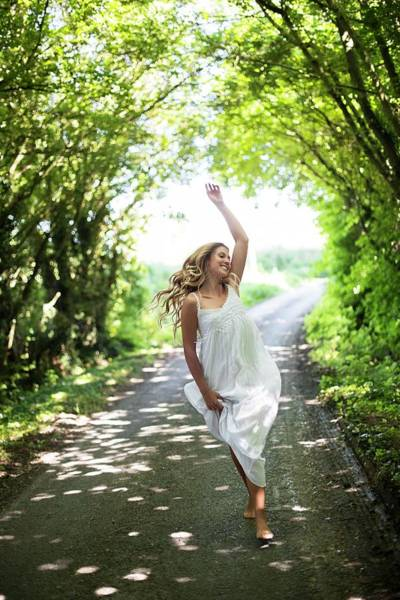 One Way Road Photograph - Young Woman Dancing On Country Lane by Ian Hooton/science Photo Library