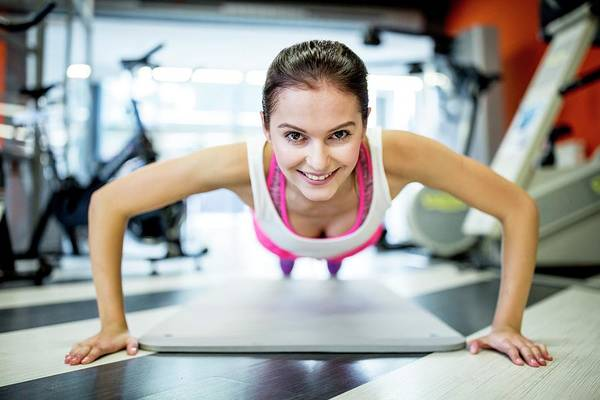 Self Confidence Photograph - Young Woman Doing Press-ups by Science Photo Library