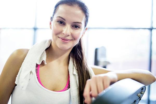 Self Confidence Photograph - Young Woman In Gym by Science Photo Library