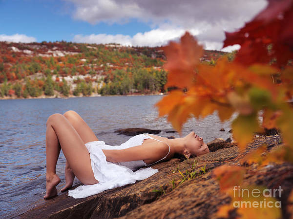 Erotism Photograph - Young Woman In White Dress Lying On Shore Of Lake In Fall by Oleksiy Maksymenko