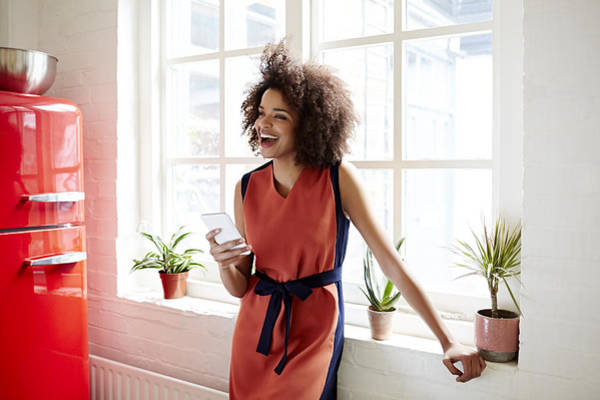 Young Woman Laughing In A Trendy Apartment Art Print by Ezra Bailey