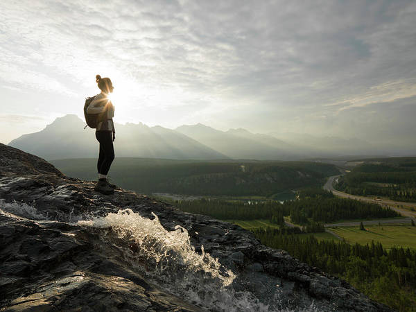 Adolescence Photograph - Young Woman Looks Across Mtns And by Ascent Xmedia