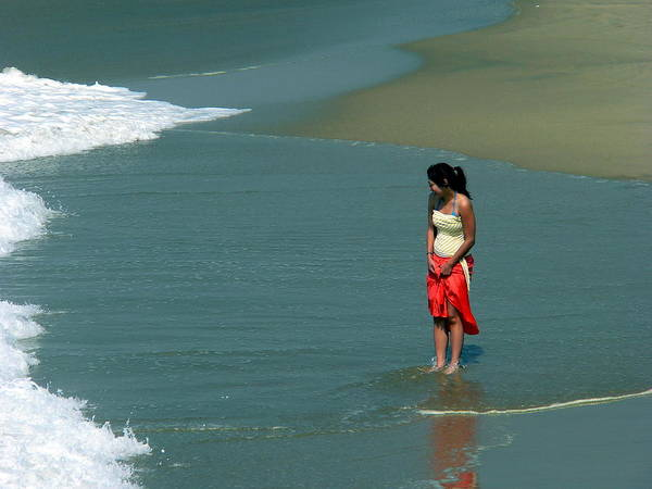 Photograph - Young Woman Playing In The Surf by Jeff Lowe