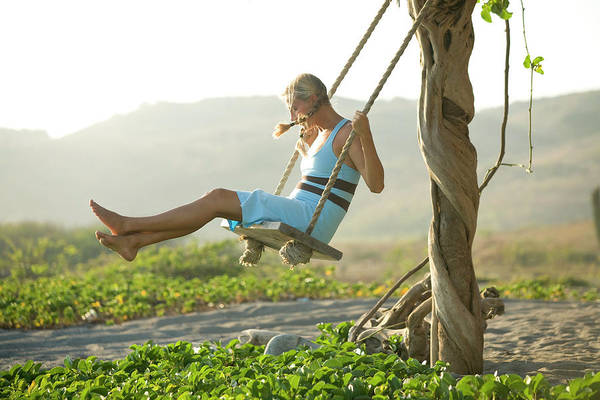 Wall Art - Photograph - Young Woman Playing On Swing On Beach by Justin Bailie