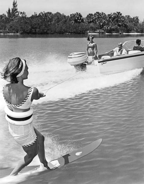 Vacation Time Photograph - Young Woman Slalom Water Skis by Underwood Archives