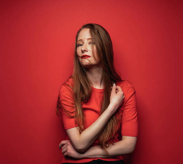 Photograph - Young Woman With Red Hair On Red by Ian Ross Pettigrew