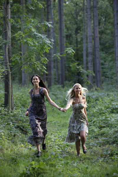 Young Women Running Through Forest Art Print by Asia Images