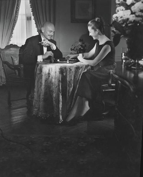 Playing Photograph - Yul Brynner Playing Backgammon With His Wife by Horst P. Horst