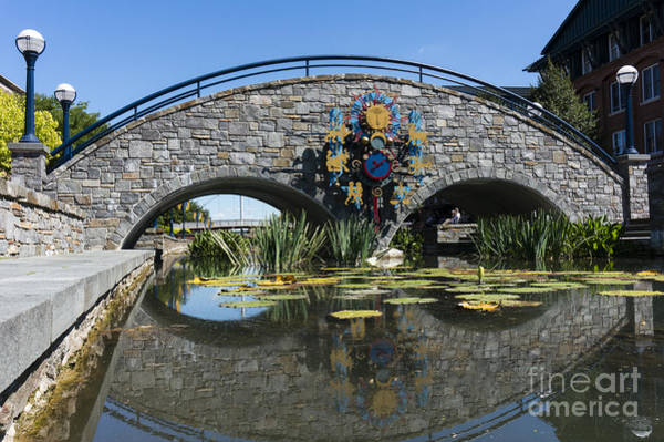 Photograph - Zodiac Inspired Clock On A Stone Bridge In Carroll Creek Park In Frederick Maryland by William Kuta
