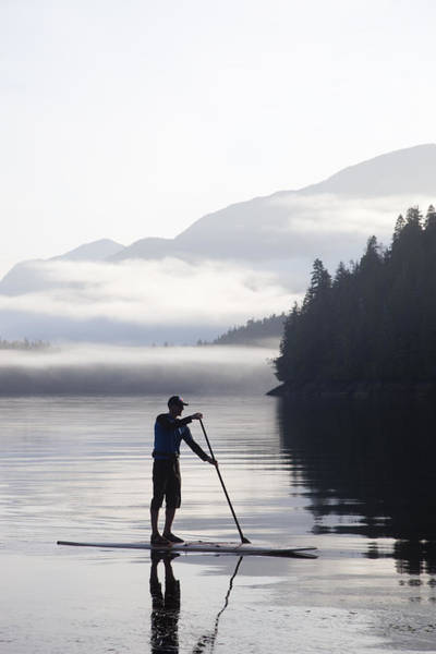Standup Paddleboard Photograph -  A Man Standup Paddleboards Across An by Taylor S. Kennedy