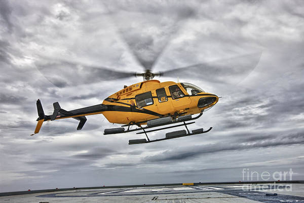 Utility Helicopter Photograph - A Bell 407 Utility Helicopter Prepares by Terry Moore