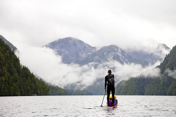 Wall Art - Photograph - A Man Paddle Boards In The Rain by Taylor S. Kennedy