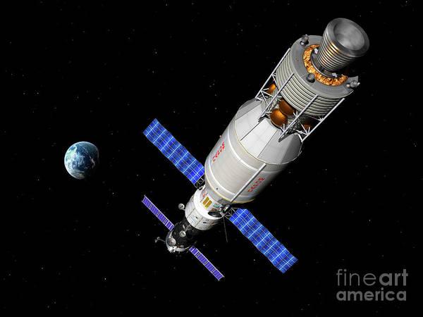 Orion Digital Art - A Manned Soyuz Tma-m Spacecraft Docked by Walter Myers