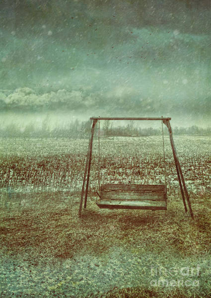 Photograph - Abandoned  Swing In First Snow Storm Of Winter by Sandra Cunningham