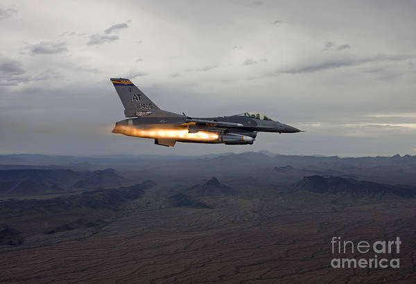 National Guard Photograph - An F-16 Fighting Falcon Fires An Agm-65 by HIGH-G Productions