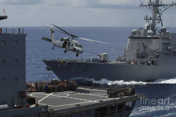 Amphibious Assault Ship Wall Art - Photograph - An Mh-60s Knighthawk Helicopter by Stocktrek Images