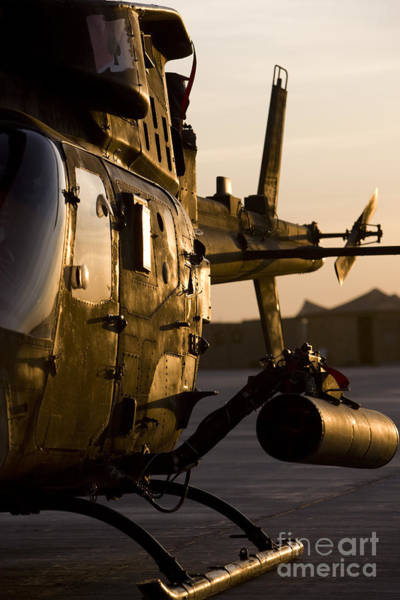 Utility Helicopter Photograph - An Oh-58d Kiowa During Sunset by Terry Moore