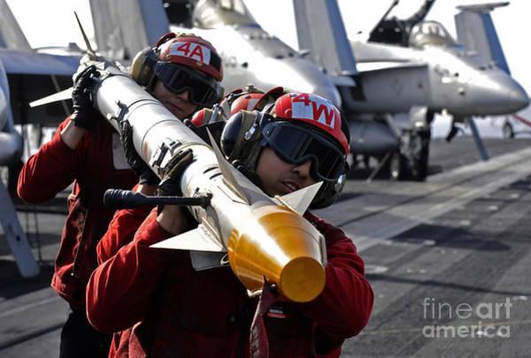 Uss Carl Vinson Photograph - Aviation Ordnancemen Carry An by Stocktrek Images