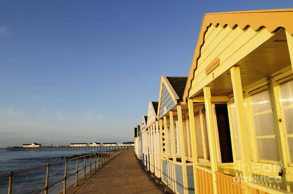 Southwold Wall Art - Photograph - Beach Huts And Pier At Southwold by Liz Pinchen
