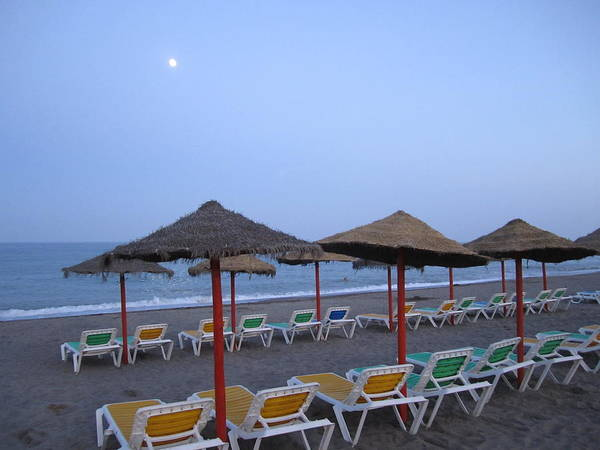 Photograph - Beach Umbrellas And Chairs Moon Lit Costa Del Sol Spain by John Shiron