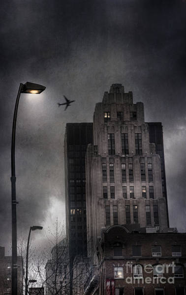 Photograph - City Buildings With Dark Ominous Clouds by Sandra Cunningham