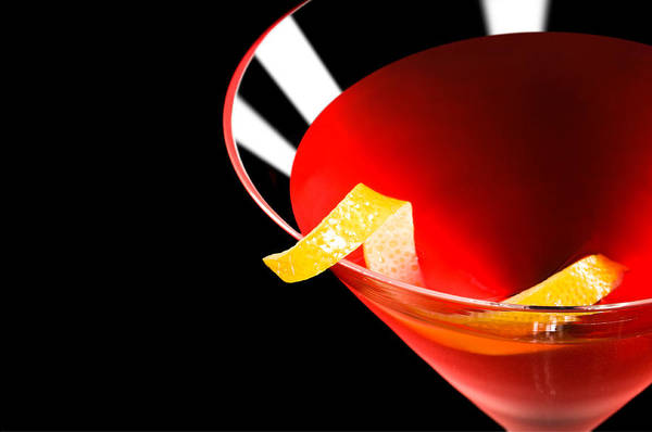 Photograph - Cosmopolitan Cocktail In Front Of A Black Background by U Schade