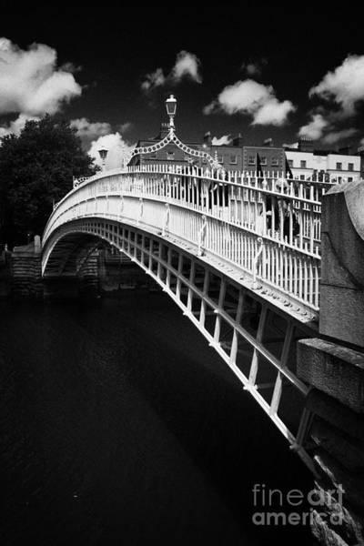 Wall Art - Photograph - Halfpenny Hapenny Bridge Over The River Liffey In The Centre Of Dublin Ireland by Joe Fox