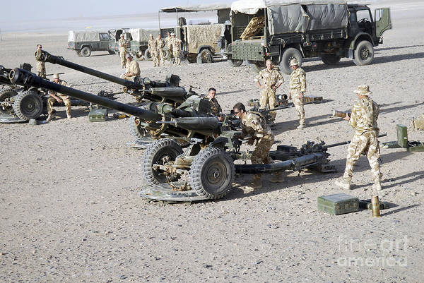 Royal Artillery Wall Art - Photograph - Howitzer 105mm Light Guns Are Lined by Andrew Chittock