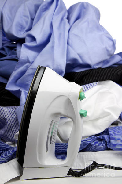 Toil Photograph - Ironing by Blink Images