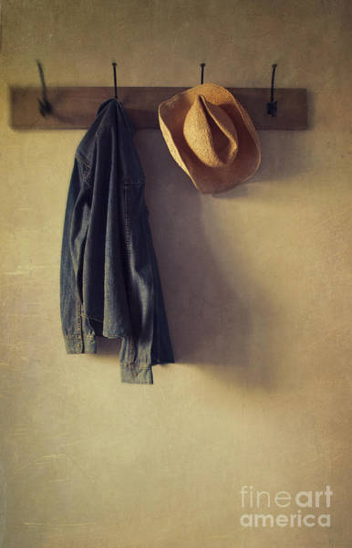 Photograph - Jean Shirt And Straw Hat Hanging On Hooks by Sandra Cunningham