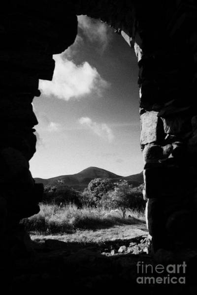 Wall Art - Photograph - looking out at Slieve Donard in the mourne mountains from the ruins of maghera old church by Joe Fox