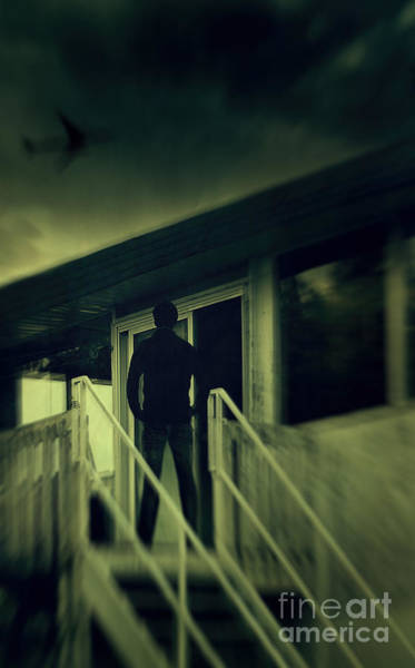 Photograph - Man Standing On Balcony Looking Up At The Darken Sky by Sandra Cunningham