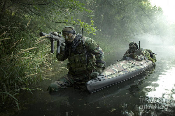 Photograph - Navy Seals Navigate The Waters by Tom Weber