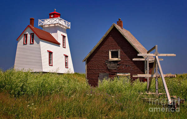 Juxtaposition Photograph - North Rustico Lighthouse by Louise Heusinkveld