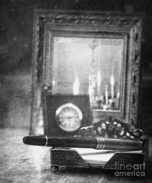 Photograph - Nostalgic Still Life Of Writing Pen With Clock In Background by Sandra Cunningham