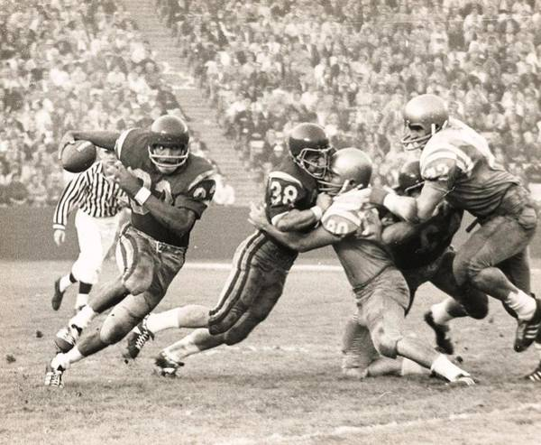 Photograph - Oj Simpson Carrying The Ball Against Ucla by Jamie Baldwin
