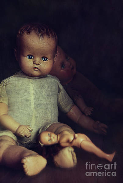 Doll Parts Photograph - Old Dolls Sitting On Wooden Table by Sandra Cunningham