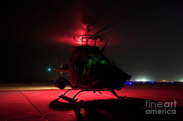 Kiowa Photograph - Pilots Prepare For Takeoff In An Oh-58d by Terry Moore