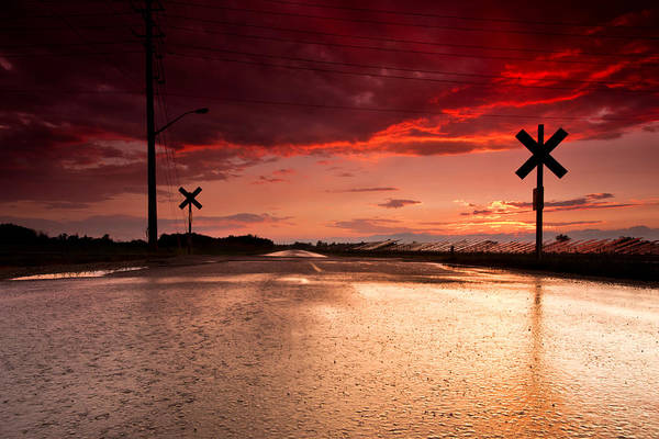 Rail Crossing Photograph - Railroad Sunset by Cale Best