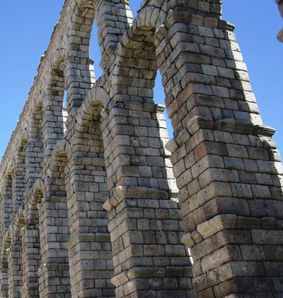 Photograph - Segovia Ancient Roman Aqueduct Architectural Granite Stone Structure V With Arches In Spain by John Shiron