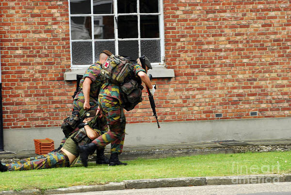 Fnc Photograph - Soldiers Of The Belgian Army Helping by Luc De Jaeger