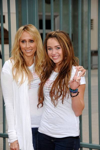 Miley Cyrus Wall Art - Photograph - Tish Cyrus, Miley Cyrus In Attendance by Everett