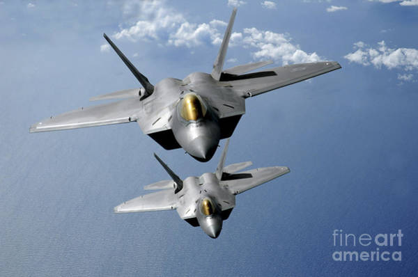 Photograph - Two F-22 Raptors Fly Over The Pacific by Stocktrek Images