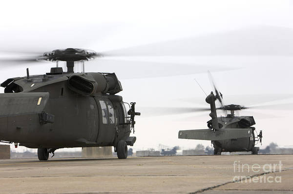 Taxiway Wall Art - Photograph - Two Uh-60 Black Hawks Taxi by Terry Moore