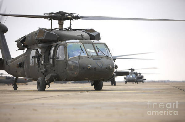 Utility Helicopter Photograph - Uh-60 Black Hawks Taxis by Terry Moore