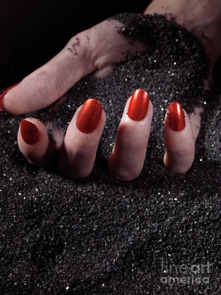 Burried Photograph - Woman Hand With Red Nails On Black Sand by Oleksiy Maksymenko