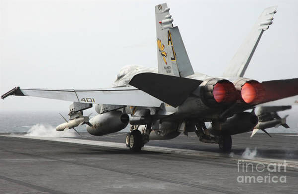 Flight Deck Photograph - An Fa-18c Hornet Launches by Stocktrek Images